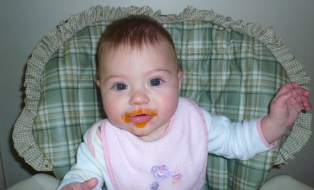 Ashley is thoroughly enjoying her food.